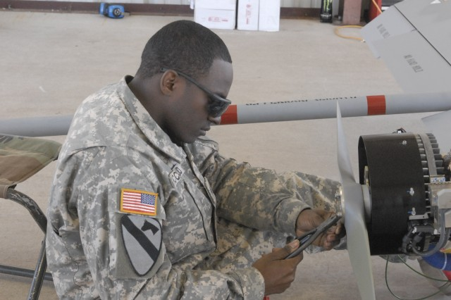 FORT HOOD, Texas-Sgt. Antonio Mccloud, an unmanned aerial vehicle maintainer assigned to Alpha Company's Tactical Unmanned Aerial System, 4th Brigade Special Troops Battalion, 1st Cavalry Division, conducts pre-flight checks on a unmanned aerial vehicle during the UAV training at Landing Strip Cold Range, Mar. 12.