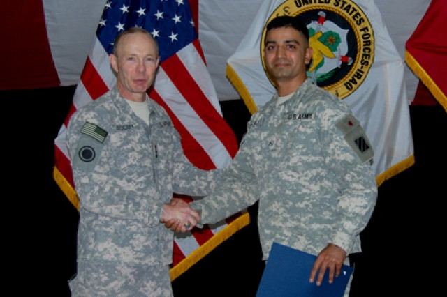 Lt. Gen. Charles H. Jacoby Jr., United States Forces - Iraq deputy commanding general for operations, congratulates Pvt. Falak Mir Shafi, A Troop, 3rd Squadron, 1st Cavalry Regiment, 3rd Heavy Brigade Combat Team, 3rd Infantry Division, after a ceremony at Camp Victory, Baghdad, Iraq, Feb. 15, 2010, on earning his U.S. citizenship.