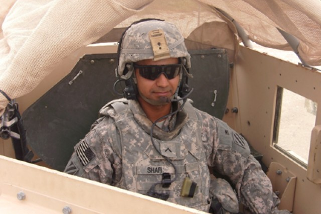Pvt. Falak Mir Shafi, A Troop, 3rd Squadron, 1st Cavalry Regiment, 3rd Heavy Brigade Combat Team, 3rd Infantry Division, stands in the gunner's turret prior to heading out on a mission.  Shafi recently earned his citizenship through military service and took the oath of citizenship during a ceremony at Camp Victory, Baghdad, Iraq, Feb. 15, 2010.