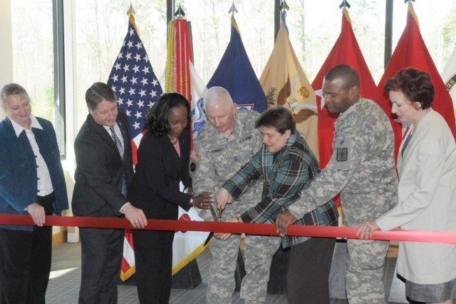 The U.S. Army Women's Museum held its grand opening and ribbon-cutting ceremony for its new expansion during the Women's History Month Program, March 19 at Fort Lee, Va. From left, Francoise Bonnell, Army Women's Museum acting director; William Moore, deputy to the commanding general, Combined Arms Command and Sustainment of Excellence; retired Command Sgt. Maj. Michele S. Jones, special assistant to the Secretary of Defense White House Liaison; Maj. Gen. James E. Chambers, CASCOM, SCoE and Fort Lee commanding general; retired Maj. Gen. Dee McWilliams, Army Women's Foundation president; Brig. Gen. Jesse R. Cross, Quartermaster School commanding general; and Peggy Trossen, Army Women's Foundation executive director.