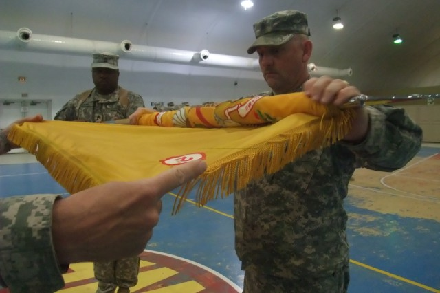 CONTINGENCY OPERATING LOCATION Q-WEST, Iraq -With the help of his commander, Lt. Col. Kerry W. Goodman, Command Sgt. Maj. Perry Campbell cases the 2nd Battalion, 198th Combined Arms colors during a Transfer Of Authority ceremony between 1st Squadron, 278th Armored Cavalry Regiment and 2nd Battalion, 198th Combined Arms March 10.