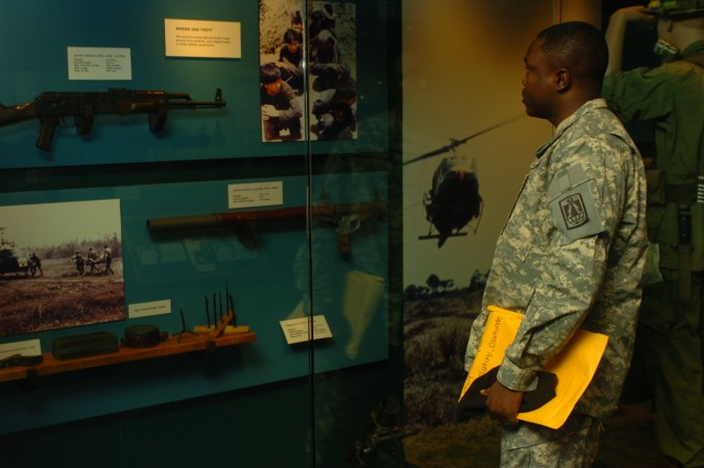 Staff Sgt. Olatunde Olatunji, inspects a display of weapons and supplies used by Tropic Lightning veterans during the Vietnam War at the Tropic Lightning Museum on Schofield Barracks, Hawaii.