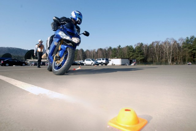 Staff Sgt. Kenneth Wideman from the 226th Medical Logistics Battalion completes a left turn during the third exercise of the U.S. Army Garrison Kaiserslautern's Motorcycle Safety Foundation Training Course at the Motorcycle Range on Kapaun Air Station, Germany.
