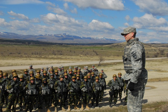 2nd Lt. Todd Rossbach, a St. Paul, Minn., native and a platoon leader for 1st Platoon, 230th Miltary Police Company, 95th Military Police Battalion, addresses Macedonian and U.S. troops during a safety brief March 17 at Army Training Area Krivolak in Macedonia. 230th MP Co. Soldiers travelled to the Republic of Macedonia March 11-22 to train Macedonian soldiers on crew-served weapons in preparation for their upcoming deployment to Afghanistan.