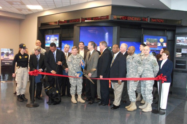 Brig. Gen. Christopher Tucker leads the ribbon cutting.