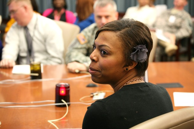 Kenya McLin, operations research analyst, Concepts Analysis Lab, Tech Center, ponders an answer to a question during the U.S. Army Space and Missile Defense Command/Army Forces Strategic Command's Women's History Jeopardy Contest March 23.
