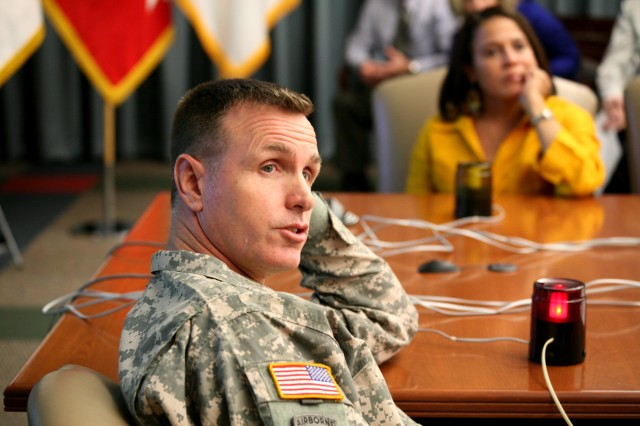 Maj. Kenneth Kemmerly, CIO-G6 operations officer, answers a question during the U.S. Army Space and Missile Defense Command/Army Forces Strategic Command's Women's History Jeopardy Contest March 23.