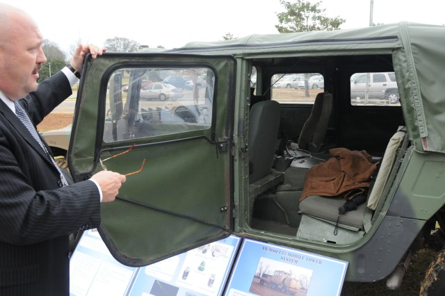 Jim Kelton of the Office of the Product Manager for Air Traffic Control Systems, Redstone Arsenal, shows the inside of a Tactical Terminal Control System during the March 16-19 Air Traffic Services Leaders Conference at Fort Rucker. The unit was one of a few on display in front of The Landing.