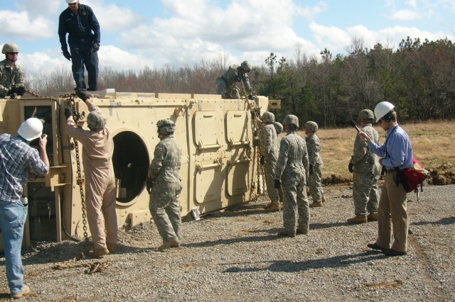 Fort Campbell Soldiers practice trying to upright a flipped MRAP during a 12-day course taught by a team from Fort Jackson's 187th Ordnance Battalion last week.