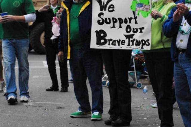 Spectators at Savannah's St. Patrick's Day Parade show their support for troops, March 17.