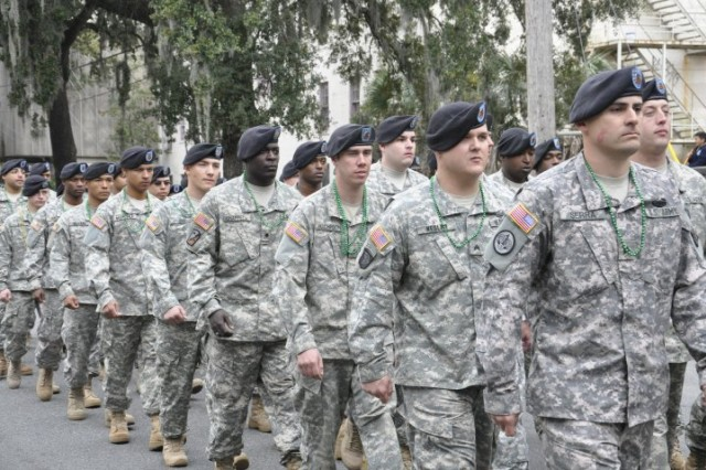 Soldiers from the 260th Quartermaster Battalion march through the streets of downtown Savannah in the 186th annual St. Patrick's Day Parade, March 17.