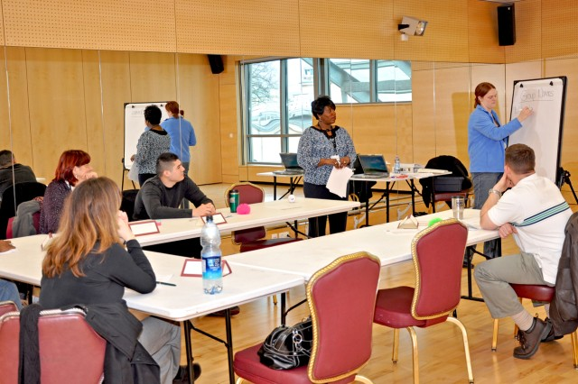 Delegates discuss issues during the Army Family Action Plan Conference in Wiesbaden Feb. 24. The annual event gives community members the opportunity to play a role in improving the overall quality of life in the U.S. Army by raising issues of concern to Army leadership. See page 6 for coverage of U.S. Army Garrison Baumholder's conference and the next issue of the Herald Union for coverage of the Wiesbaden AFAP event.