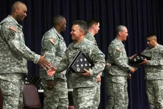 Soldiers from the 328th Human Resources Company and 363rd Quartermaster Battalion receive medals and framed flags March 20 during a Welcome Home Warrior-Citizen ceremony at Fort Sam Houston.