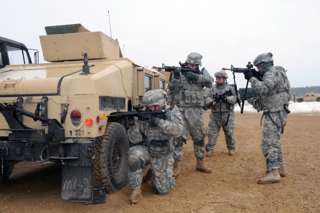 Soldiers from the 379th Engineer Company take a defensive security position by a Humvee guntruck on a Fort McCoy training lane. The Soldiers are Spc. Jacob Gaylord, Spc. Paul Alves, Pvt. Brad Feola and Spc. David Demattos. The 379th, a Massachusetts Army National Guard unit, is training to deploy in support of Operation Enduring Freedom.
