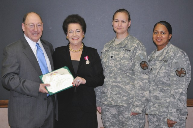Evelyn Zicko recently retired after serving 40 years as a Department of the Army civilian at Natick, Mass. Before her retirement, she received the Department of the Army's Superior Civilian Service Award. Pictured, from left, Russ Hall, IMCOM Northeast Region Director, Evelyn Zicko, Lt. Col. Kari Otto, USAG-Natick commander and Command Sgt. Maj. Mittie Smith.