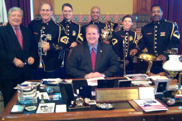 """Members of the Brass Quintet from United States Army Band Pershing's Own,"""" pose with Governor Chester J. Culver, governor of Iowa, March 23, 2010 at his office. The Brass Quintet is participating in a United States Army Recruiting Command tour to the University of Iowa, University of Kansas and University of Oklahoma. Pictured are Governor Chester J. Culvert (seated) and from left to right, James Larew, Chief of Staff to the Governor (high school classmate of Sgt. Maj. Dennis Edelbrock),  Sgt. Maj. Dennis Edlebrock, Sgt. 1st Class Terry Bingham, Master Sgt. Joe Lovinsky, Sgt. 1st Class Kirsten Lies-Warfield and Staff Sgt. David Kirven."""