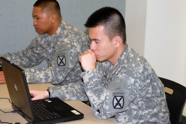 Spc. Tai Tran, Company A, 1st Battalion, 32nd Infantry Regiment, takes a Post Combat Survey March 17.