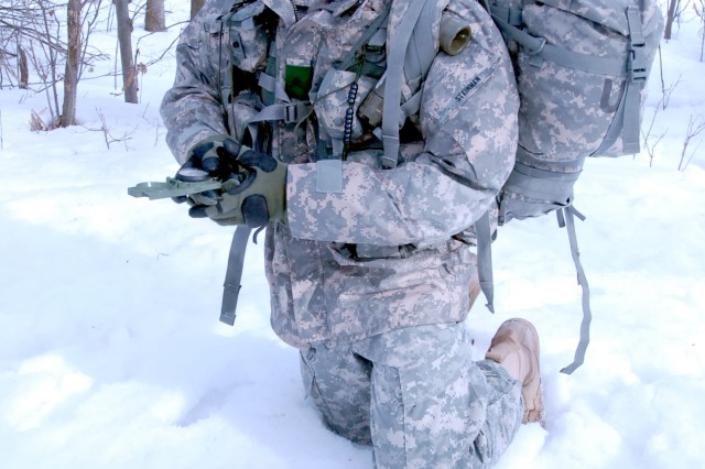 Fort Drum Noncommissioned Officer of the year, Sgt. Eric Steinman, a military policeman with 511th Military Police Company, 91st MP Battalion, uses his compass to find a heading during the land navigation portion of the NCO of the year competition March 4.