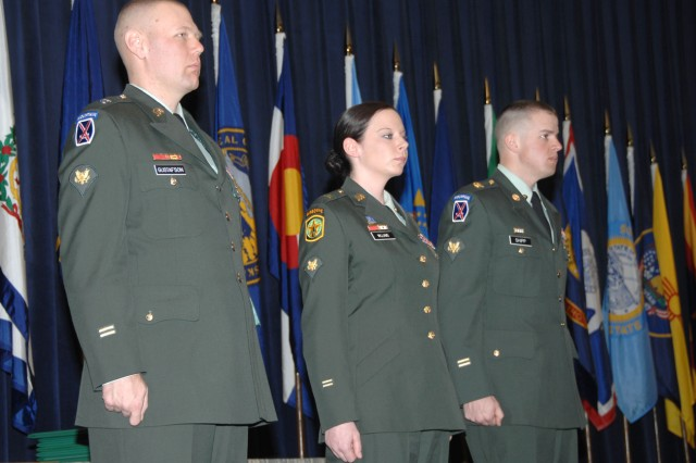 Warrior Leader Course award winners stand to be recognized during their graduation ceremony. From left are Spc. Jerry A. Gustafson, Distinguished Honor Graduate; Spc. Amber L. Williams, John D. Magrath Leadership Award recipient; and Spc. Benjamin J. Shipp, commandant's inspection winner.