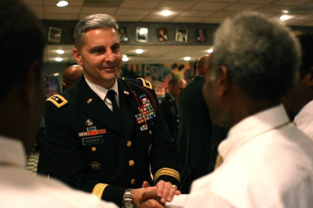 "Maj. Gen. Tony Cucolo, commander of the 3rd Infantry Division, welcomes Chief Mangau and the other tribesmen to Fort Stewart, Ga., on the Travel Channel's ""Meet the Natives: USA."" He awarded World War II-era campaign medals to Mangau in honor of his father."