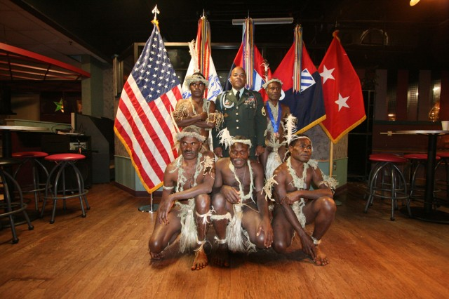 """Staff Sgt. Steve Shepard of the 3rd Infantry Division poses with the Pacific Islanders he welcomed to his home as part of the Travel Channel's """"Meet the Natives: USA"""" series. The episode aired Dec. 20, 2009."""