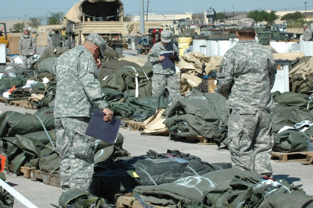 Soldiers at the 289th identify, check and record turned-in materiel for later tagging and distribution.