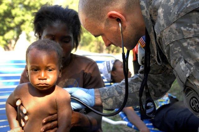 Soldiers conduct relief efforts in Haiti after a devastating earthquake.