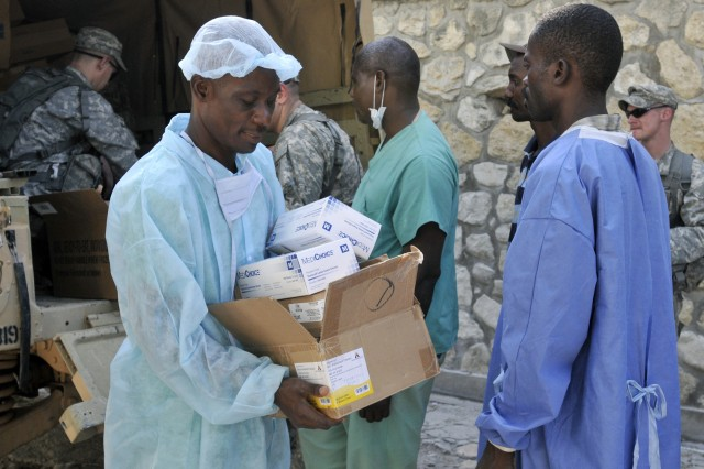 Medics assigned to 2nd Battalion, 319th Airborne Field Artillery Regiment, 2nd Brigade Combat Team, 82nd Airborne Division, deliver medical supplies to Ofatma Hospital in Port-au-Prince, Haiti, Jan. 23.