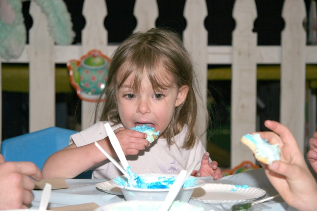 FORT CARSON, Colo.-Willo Spahr, 3, enjoys the cookie she decorated at the Mad Hatter's Unbirthday Party at Eggsperience Wonderland March 20 at the Special Events Center.