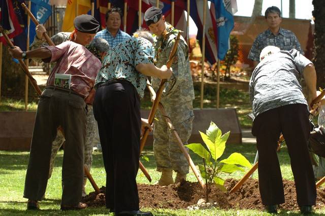 FORT DERUSSY, Hawaii -- Col. Matthew Margotta, commander, U.S. Army Garrison-Hawaii, assists local native Hawaiian community leaders with the planting of an Ulu tree following the Native Hawaiian Covenant signing between the local Hawaiian community and U.S. Army-Hawaii, here, March 24.