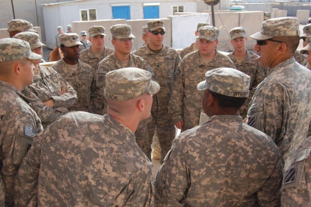 Level-one combative graduates from the 3rd Brigade Special Troops Battalion, 3rd Heavy Brigade Combat Team, 3rd Infantry Division, get a pre-graduation motivational talk from Sgt. 1st Class Pablo Palomar, battalion operations noncommissioned officer-in-charge, before a ceremony March 19 at Contingency Operating Site Kalsu, Iraq. The one-week class taught over 40 hand-to-hand combat maneuvers. Twenty-two Soldiers began the BSTB-organized course, and 20 marched across the stage at graduation day to receive their certificate.
