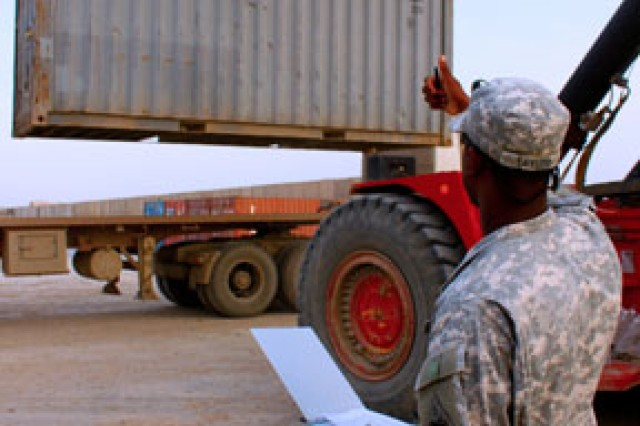 Spc. Vincent Taylor, Headquarters Troop, 2nd Squadron, 13th Cavalry Regiment, a supply specialist from Virginia Beach, Va., directs equipment movement in preparation for an upcoming foreign excess personal property inventory and equipment retrograde from Contingency Operating Station Hunter, Iraq, Feb. 19, 2010. The unit is deployed from Fort Bliss, Texas, to advise and assist in Maysan Province.