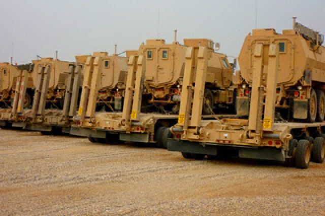 Army M1070 Heavy Equipment Transporters on Contingency Operating Station Hunter are staged to retrograde Mine-Resistant  Ambush-Protected vehicles prior to transitioning the base to Iraqi control.