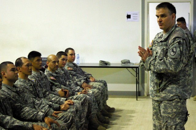The commander of the 1-144th Maneuver Task Force, Lt. Col. David Brady, Modesto, Calif., talks to eight Soldiers sworn in as U.S. citizens at a Camp Bondsteel, Kosovo, ceremony on March 25 about the need to fulfill all their civic duties and responsibilities.