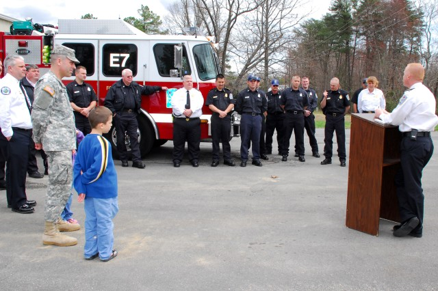 """Fort A.P. Hill Fire Chief Daniel Glembot explains the age-old tradition of the """"Push In"""" ceremony held Tuesday to recommission Fire Engine #7. The """"Push In"""" tradition dates back to the 1700s when horses would pull pumper wagons and couldn't back the pumpers up for equipment to be loaded."""