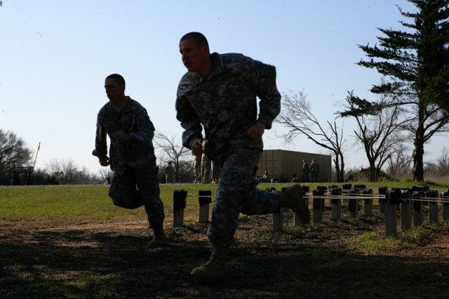 A pair of unidentifiable runners take on Fort Sill's Combat Confidence Course on March 19, 2010 with F Battery, 1st Battalion 40th Field Artillery.
