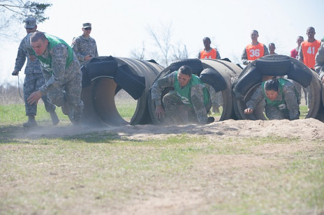 Soldiers from Crusaders platoon hurried through cylinders at the starting line at the Combat Confidence Course March 19, 2010. Despite crawling, running and climbing as fast as they could, the team was defeated by the Regulators platoon.