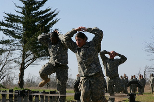 Arms up and behind their heads, Soldiers in F Battery, 1st Battalion, 40th Field Artillery carefully maneuver through obstacles at Fort Sill's Combat Confidence Course March 19, 2010.