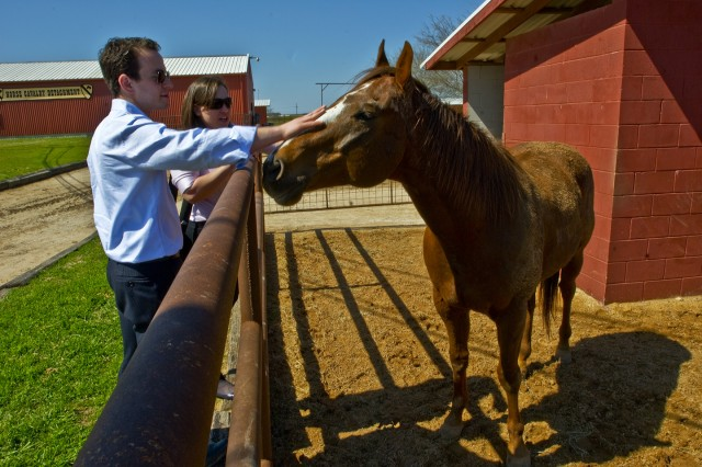 FORT HOOD, Texas-Iraq and Afghanistan Veterans of America Policy Director Jonathon Schleifer, of Washington, D.C. and New York native, Veteran Support Associate, Cara Hammer, visit with 'Zoro', a member of the 1st Cavalry Division Horse Cavalry Detachment, here,  March, 17.