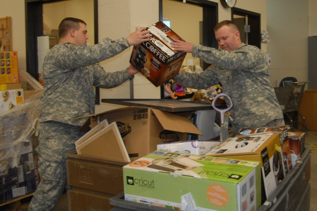 COLORADO SPRINGS, Colo. -Sgt. 1st Class Michael West, Headquarters and Headquarters Detachment, 2nd Battalion, 8th Infantry Regiment, 2nd Brigade Combat Team, 4th Infantry Division, helps Spc. Andrew Bias, HHD, 2nd Bn., 8th Inf. Reg., 2nd BCT, 4th Inf. Div., sort out donations at a local Goodwill store.   Soldiers of their unit volunteer at different organizations around the Colorado Springs area.