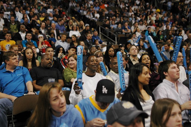 DENVER-Members of the Fort Carson community enjoy the NBA game between the Denver Nuggets and the New Orleans Hornets after its victory over the Air Force at the Pepsi Center in Denver.
