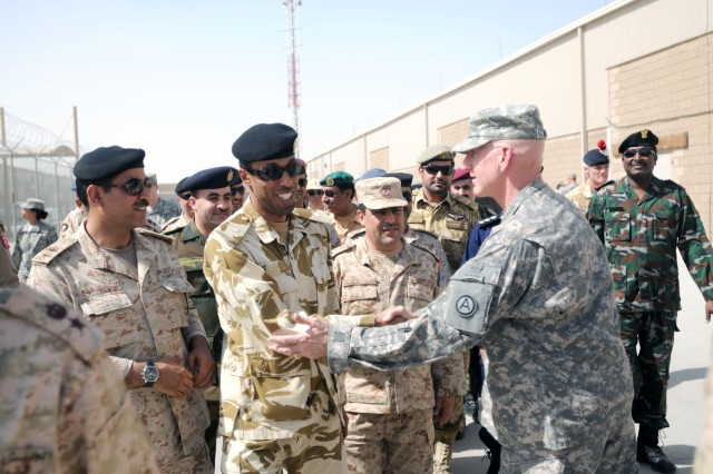 Maj. Gen. Gregg Martin (right), deputy commanding general of U.S. Army Central/Third Army (Third Army) in Kuwait, shakes hands with servicemembers different nations attending the Third Army and Kuwait Joint Command and Staff College Orientation visit in Kuwait March 18. The event played a critical role in Third Army's support of Kuwait and strengthening relationships with allies in the Middle East.