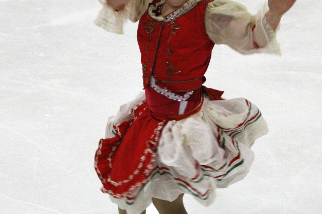 Ann-Marie Miller, 9, performs her Olympic-themed piece honoring the traditional dress and dance of Hungary during a dress rehearsal March 18, at Cleland Ice Rink.  Participants in Fort Bragg's Learn to Skate Program will be competing Saturday in Yorktown, Va.