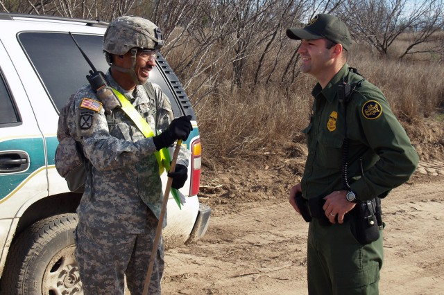 FORT BLISS, Texas - Sgt. John Mason, a safety noncommissioned officer with 94th Engineer Battalion, discusses a border road engineer mission with a U.S. Border Patrol - Laredo Sector agent.  Soldiers from the 94th Engineer Battalion, based at Fort Leonard Wood, Mo., deployed to the United States - Mexico border in January to provide engineer support to the U.S. Border Patrol - Laredo Sector. The Border Patrol agents maintained security for the Soldiers throughout the execution of the JTF-North support mission.