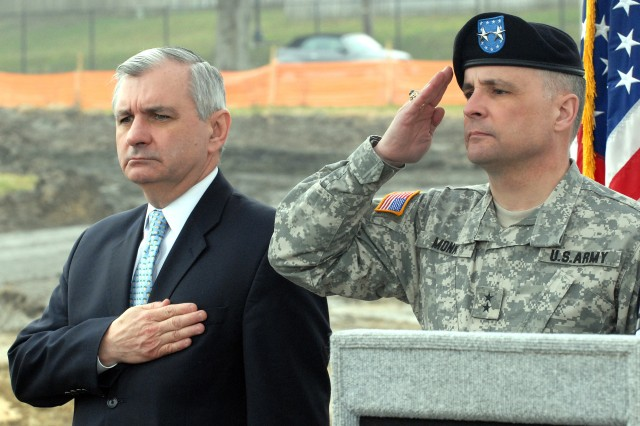 U.S. Sen. Jack Reed of Rhode Island, left, and Maj. Gen. William Monk III, commanding general, 99th Regional Support Command (RSC), render honors during the March 22 ground-breaking ceremony for the new Army Reserve Center at Naval Station Newport, R.I. The center is being built by the 99th RSC, which is headquartered at Joint Base McGuire-Dix-Lakehurst, N.J. (Photo by Shawn Morris)