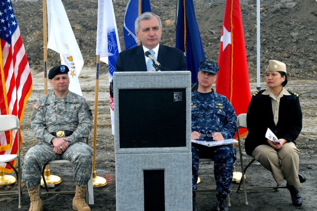 U.S. Sen. Jack Reed of Rhode Island addresses the crowd and Maj. Gen. William Monk III, commanding general, 99th Regional Support Command (RSC), left, Navy Capt. Joe Voboril, commanding officer, Naval Station Newport, and Chap. (Lt. Cmdr.) Judy Malana, command chaplain, Naval War College, right, during the March 22 ground-breaking ceremony for the new Army Reserve Center at Naval Station Newport, R.I. The center is being built by the 99th RSC, which is headquartered at Joint Base McGuire-Dix-Lakehurst, N.J. (Photo by Shawn Morris)