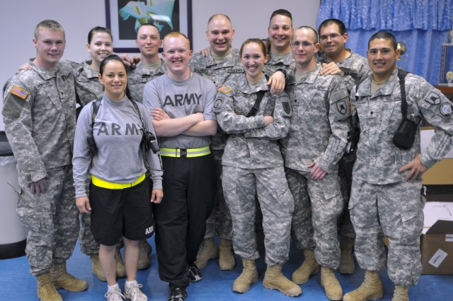 """Some of the JEC members involved with the Soldier""""s Pantry. (Back row from left to right) Spc. Cody A. Siverston, Valley City, N.D., Spc. Callie C. Craddock, Fargo, N.D., Spc. Jon P. Stautz, Valley City, N.D, Spc. Lance R. Schillinger, Gwinner, N.D., Spc. Timothy E. Stewart, Manhattan, Kan., Spc. Jon J. Berry, Fergus Falls, Minn., and Spc. Daniel T. Teviet, (Front left to right) Spc. Shanna R. Leno, Driscoll, N.D., Spc. Pat C. Stine, Crete, Ill., Spc. Melinda D. Wendel, Fargo, N.D., and Spc. Joshua F. Dietz, Buffalo, N.D."""