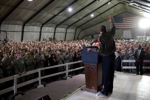 President Barack Obama waves to U.S. troops at Bagram Air Field in Afghanistan, March 28, 2010.