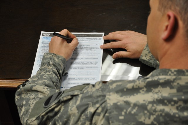 Photo Illustration: U.S. Army Forces Command Soldier attempts to complete his 2010 Census form. The Census results determine the distribution of about $400 billion per year, according to the U.S. Department of Commerce. This money is what funds community services nationwide, services that also benefit Soldiers and their Families.