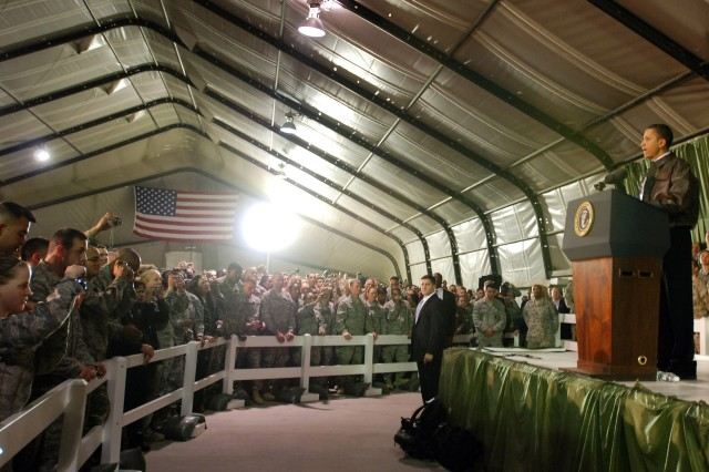 BAGRAM AIRFIELD, Afghanistan - The President of the United States Barack Obama gives a speech to servicemembers and civilians stationed at Bagram Airfield during surprise visit to Afghanistan, March 28. Prior to speaking to the troops, Obama flew to Kabul to meet with Afghanistan's president Hamid Karzai. (Photo by U.S. Army Staff Sgt. Susan Wilt, Combined Joint Task Force-82 Public Affairs)